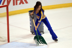 A St. Louis Blues Ice Girl clears the loose ice from the Vancouver Canucks goal mouth during a time out of their game in the first period at the Scottrade Center in St. Louis on April 16, 2013.  UPI/Bill Greenblatt
