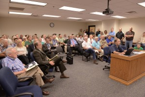 A full hearing room listens to testimony from Doctor James Kroll of Stephen F. Austin University about chronic wasting disease management.  (Photo courtesy; Tim Bommel, Missouri House Communications)