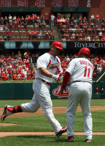 St.Louis Cardinals Matt Holliday (L) gets congratulation from Jose Oquendo after his home run in the 1st inning at Busch Stadium in St. Louis on July 7, 2013. The Cardinals defeated the Marlins 3-2.    UPI/Rob Cornforth