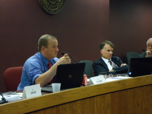 Stoddard County Prosecutor Russell Oliver (left) questions a witness testifying to the Bipartisan Investigative Committee on Privacy Protection, as chairman Stanley Cox (right) listens.