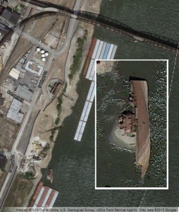 The Inaugural lies on its side in the Mississippi River about a half-a-mile from the Poplar Street Bridge in St. Louis.  (Image courtesy, Google Maps)