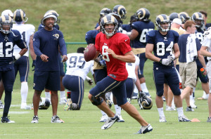 St. Louis Rams quarterback Sam Bradford runs a play during training camp at the team practice facility in Earth City , Missouri on July 29, 2013.   UPI/Bill Greenblatt