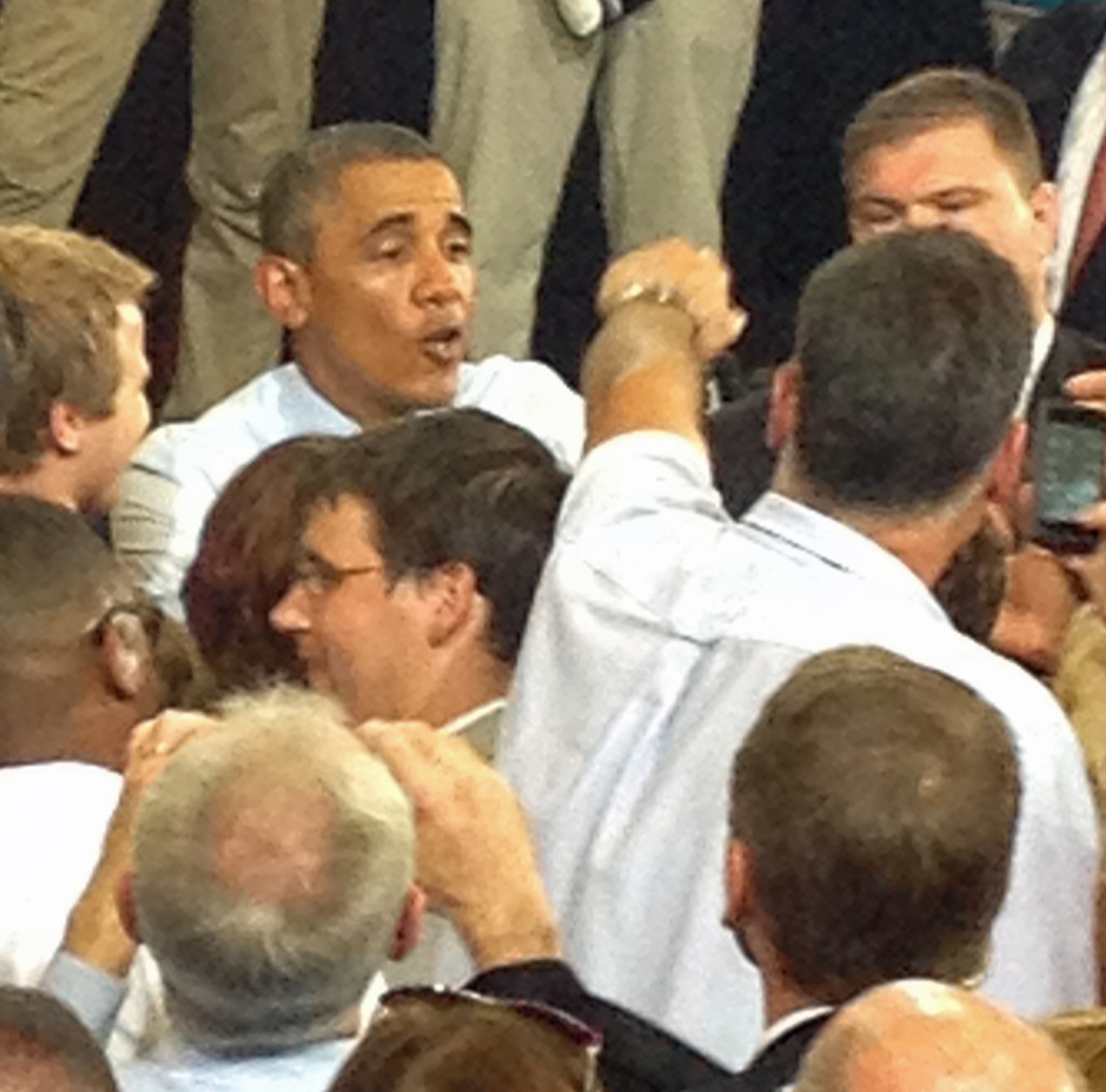 President Obama goes in for a fist bump while mingling with the crowd after his speech at UCM in Warrensburg. (Missourinet photo by Claire Jurgensmeyer)