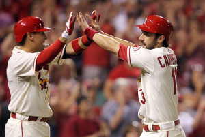St. Louis Cardinals Matt Carpenter (R) slaps hands with Allen Craig after crossing home plate on a two RBI double by Matt Holliday in the seventh inning against the Atlanta Braves at Busch Stadium in St. Louis on August 24, 2013.   UPI/Bill Greenblatt