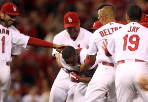 St. Louis Cardinals Adron Chambers is mobbed by teammates after getting the game winning hit in the 14th inning against the Pittsburgh Pirates at Busch Stadium in St. Louis on August 13, 2013. St. Louis won the game 4-3.   UPI/Bill Greenblatt