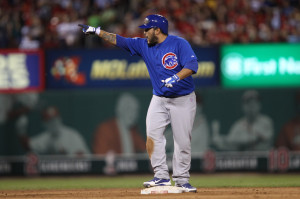 Chicago Cubs Dioner Navarro points to his dugout after hitting a RBI double scoring the go ahead run in the eighth inning against the St. Louis Cardinals at Busch Stadium in St. Louis on August 10, 2013.UPI/Bill Greenblatt