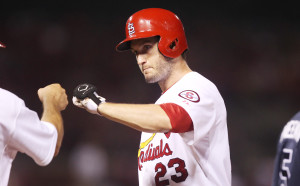 St. Louis Cardinals David Freese slaps fists with first base coach Chris Maloney after hitting a RBI single in the seventh inning at Busch Stadium in St. Louis on August 22, 2013. St. Louis won the game 6-2.   UPI/Bill Greenblatt