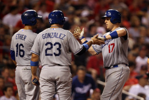 Los Angeles Dodgers A.J . Ellis (17) is congratulated at home plate by teammates Andre Ethier and Adrian Gonzalez after hitting a three run home run in the fifth inning against the St. Louis Cardinals at Busch Stadium in St. Louis on August 8, 2013.UPI/Bill Greenblatt
