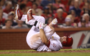 St. Louis Cardinals Matt Holliday falls down in pain while batting in the third inning against the Cincinnati Reds at Busch Stadium in St. Louis on August 27, 2013.  Holliday remained in the game.  UPI/Bill Greenblatt
