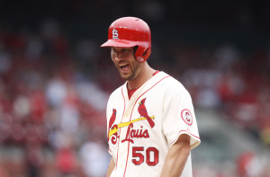 St. Louis Cardinals starting pitcher Adam Wainwright smiles to the dugout after hitting a RBI single in the  third inning against the Chicago Cubs at Busch Stadium in St. Louis on September 28, 2013.St. Louis won the game 6-2.    UPI/Bill Greenblatt
