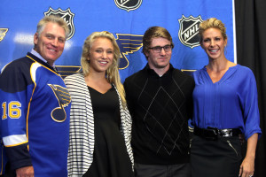 Former St. Louis Blues' all time goal scorer and Hockey Hall of Fame member Brett Hull stands with daughter Crosby, son Jude and wife Darcie after being named Executive Vice President with the club, during a press conference at the Scottrade Center in St. Louis on September 9, 2013. UPI/Bill Greenblatt