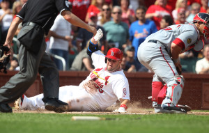 St. Louis Cardinals Matt Adams slides safely into home plate before the tag by Washington National catcher Denard Ramos in the fourth inning at Busch Stadium in St. Louis on September 25, 2013.      UPI/Bill Greenblatt