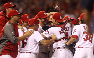The St. Louis Cardinals celebrate on the field,  after winning the National League Central Division title,  defeating the Chicago Cubs 7-0 at Busch Stadium in St. Louis on September 27, 2013. UPI/Bill Greenblatt