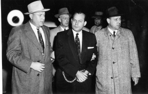 Carl Austin Hall (dark suit) is escorted by law enforcement.  (photo courtesy; Missouri State Historical Society)