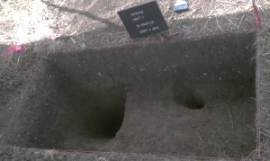 Two post holes overlap in the upper-right of this plot.  Archaeologists dug out a third post hole, at the left looking for evidence of earlier habitation.