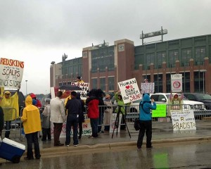 Protesters outside Lambeau Field in Green Bay.  Photo, Bill Scott