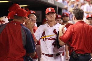 St. Louis Cardinals starting pitcher Shelby Miller is congratulated by teammates after coming out of the game in the seventh inning against the Milwaukee Brewers at Busch Stadium in St. Louis on September 10, 2013. St. Louis won the game 4-2.     UPI/Bill Greenblatt