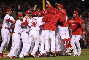 St. Louis Cardinals players celebrate on the mound after defeating the Los Angeles Dodgers 9-0 in Game 6 of the National League Championship Series at Busch Stadium in St. Louis on October 18, 2013. The Cardinals will now advance to the 2013 World Series. UPI/Bill Greenblatt