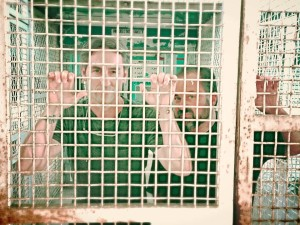 The stars of American Pickers, Mike Wolfe (left) and Frank Fritz pose inside Housing Unit 3 at Missouri State Penitentiary.  The pair visited the prison and other sites in central Missouri in July.