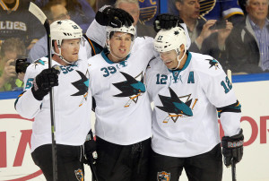 San Jose Sharks Logan Couture (39) is congratulated by teammates Matt Irwin (52) and Patrick Marleau after scoring the first goal of the game in the first period against the St. Louis Blues at the Scottrade Center in St. Louis on October 15, 2013.    UPI/Bill Greenblatt