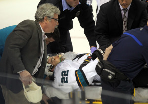 San Jose Sharks Dan Boyle is taken from the ice by stretcher after being injured in the first period against the St. Louis Blues at the Scottrade Center in St. Louis on October 15, 2013.    UPI/Bill Greenblatt