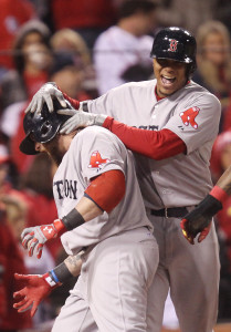 Boston Red Sox Xander Bogaerts (R) greets Johnny Gomes at home plate after Gomes hit a three run home run in the sixth inning against the St. Louis Cardinals in Game 4 of the World Series  at Busch Stadium in St. Louis on October 27, 2013. Boston won the game 4-2 and the series is now tied at two games each.  UPI/Bill Greenblatt