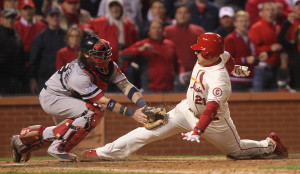 Boston Red Sox catcher Jared Saltalamacchia appears to tag out St. Louis Cardinals Allen Craig at homeplate in the ninth inning of Game 3 of the World Series at Busch Stadium in St. Louis on October 26, 2013. Craig was called safe after an interference call at third base allowed him to take a base. St. Louis won the game 5-4. UPI/Bill Greenblatt