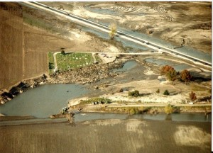 This arial image taken from south of the Hardin Cemetery in 1993 shows the levee breach that washed out the Cemetery and left the town flooded.