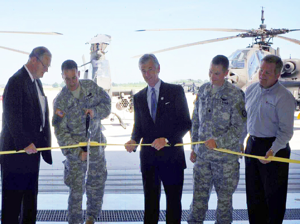 Adjutant General Stephen Danner (holding scissors) joins Congressman Ike Skelton (left) for a ribbon cutting at Whiteman Airforce Base.