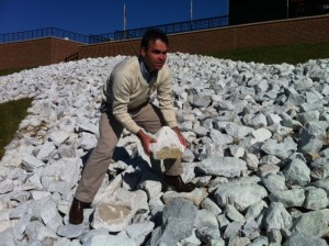 """Kevin McCrarey of SportsTalkSC.com tries to make off with one of the """"M"""" rocks."""