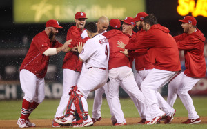 The St. Louis Cardinals begin to mob Carlos Beltran after he hit the game winning RBI single in the 13th inning to defeat the Los Angeles Dodgers, 3-2 in Game 1 of the National League Championship Series at Busch Stadium in St. Louis on October 11, 2013.   UPI/Bill Greenblatt