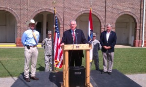 Governor Jay Nixon (at podium) announces $2.2-million for infrastructure improvements at the State Fairgrounds, joined by Agriculture Director Jon Hagler (left), Senator Mike Parson (right) and members of the Missouri National Guard.