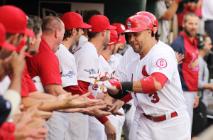 St. Louis Cardinals Carlos Beltran celebrates his three run home run in the third inning against the Pittsburgh Pirates with teammates in the dugout during Game 1 of the National League Division Series at Busch Stadium in St. Louis on October 3, 2013. UPI/Bill Greenblatt