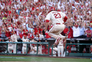 St. Louis Cardinals David Freese jumps high after scoring from third base on a sacrifice fly ball hit by Jon Jay in the fifth inning against the Los Angeles Dodgers in Game 2 of the National League Championship Series at Busch Stadium in St. Louis on October 12, 2013. St. Louis won the game 2-0 and now have a 2-0 lead in the series.  UPI/Bill Greenblatt
