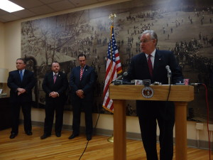 Governor Jay Nixon (at podium) announces an agreement on the use of the Missouri State Penitentiary, joined by (from left to right) Office of Administration Commissioner Doug Nelson, Jefferson City Mayor Eric Struemph and State Senator Mike Kehoe.