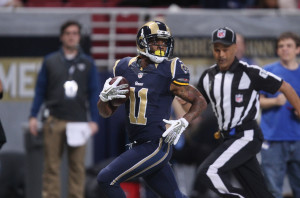 St. Louis Rams Tavon Austin looks around for a defender as he takes the football  65 yards for a touchdown in the first quarter against the Chicago Bears at the Edward Jones Dome in St. Louis on November 24, 2013. UPI/Bill Greenblatt