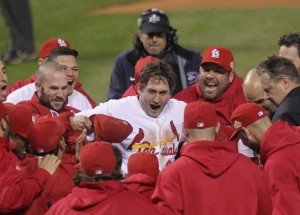 St. Louis Cardinals David Freese celebrates with his teammates at home place after hitting a solo walk off homerun to win game 6 of the World Series in the 11th inning against the Texas Rangers in St. Louis on October 27, 2011. The Cardinals defeated the Rangers 10-9 and the series is tied 6-6. UPI/Bill Greenblatt