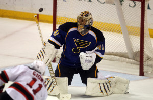 St. Louis Blues goaltender Jaroslav Halak knocks the puck away after a shot by New Jersey Devils Stephen Gionta in the third period at the Scottrade Center in St. Louis on January 28, 2014. St. Louis won the game 3-0.   UPI/Bill Greenblatt