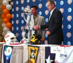 Mike Gundy (L) and Gary Pinkel (R) pose with the Cotton Bowl Classic Trophy.