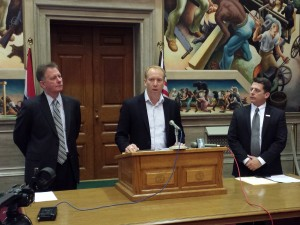 "Evergreen Education Group CEO John Watson (at podium) discusses ""K-12 Digital Learning in Missouri,"" joined by Chamber president Dan Mehan (left) and Brian Crouse, vice president of the Chamber's Education Foundation."