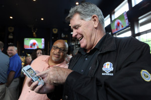 St. Louis Cardinals broadcaster Mike Shannon (R) shows broadcast partner Mike Clayborn that he can Tweet about the team's away game while in his restaurant in Edwardsville, Illinois on July 31, 2013. Shannon has taken over the team's social media site and is making comments about the team's game against the Pittsburgh Pirates as they play.     UPI/Bill Greenblatt