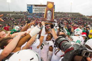 Northwest Missouri State players celebrate after winning the school's fourth NCAA Division II football national championship, Dec. 21, 2013, with a 43-28 victory against Lenoir-Rhyne in Florence, Ala. (Photo by Darren Whitley/Northwest Missouri State University)
