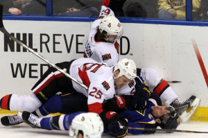 St. Louis Blues David Backes (42) his his head againist the ice after a check by the Ottawa Senators Chris Neil (25) in the first period of their game at the Scottrade Center in St. Louis on February 4, 2014.   UPI/Rob Cornforth