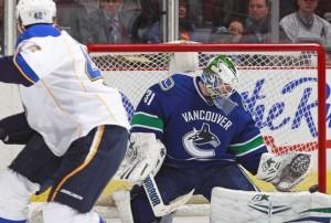 Eddie Lack makes a pad save on David Backes. (Photo, Jeff Vinick, NHL.com)