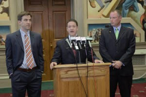 Representatives Jay Barnes (left) and Noel Torpey (right) were announced as the chairs of 2 House Interim Committees on Medicaid last summer by House Speaker Tim Jones (center).  (photo courtesy; Tim Bommel, Missouri House Communications.