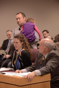 Representative Jim Neely (right) listens as Melissa and Steve Heil testify about how his bill could help their daughter.  (photo courtesy; Tim Bommel, Missouri House Communications)