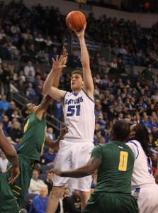 Saint Louis' Rob Loe goes up and over the George Mason defense for two points in the first half at the Chaifetz Arena in St. Louis on February 1, 2014. UPI/Bill Greenblatt