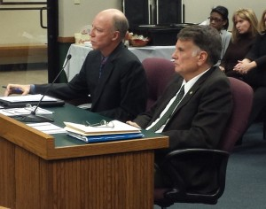 Representative Stanley Cox (right) listens as Matt Selby with the Missouri Prosecutors Association testifies in favor of Cox's bill.
