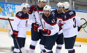 David Backes of the Blues, celebrates his goal with Team USA opponents.