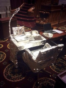 A picture circulating on Twitter late Wednesday night shows the desk of Representative Mike Lair (R-Chillicothe) in the Missouri House of Representatives' Chamber covered in tinfoil. (courtesy of Twitter user @abemesser)